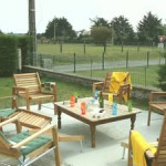Garden loungers in large rental house in Normandy